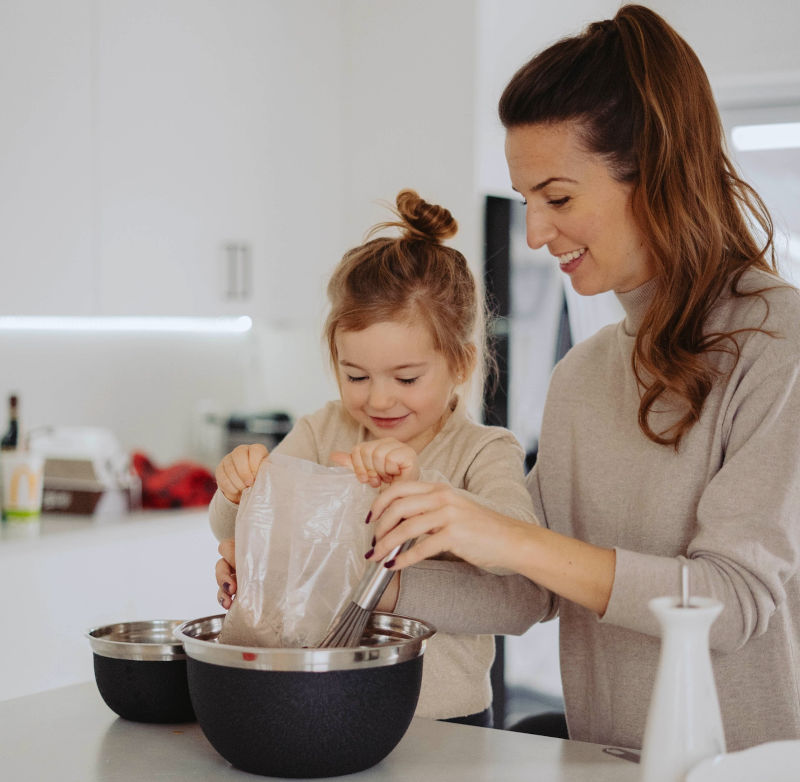 child helping mom to make cookies