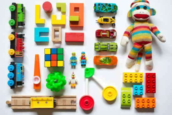Different Types of Children Toys Stacked on the Floor