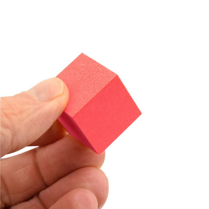 Foam Red Cube Held in Hand