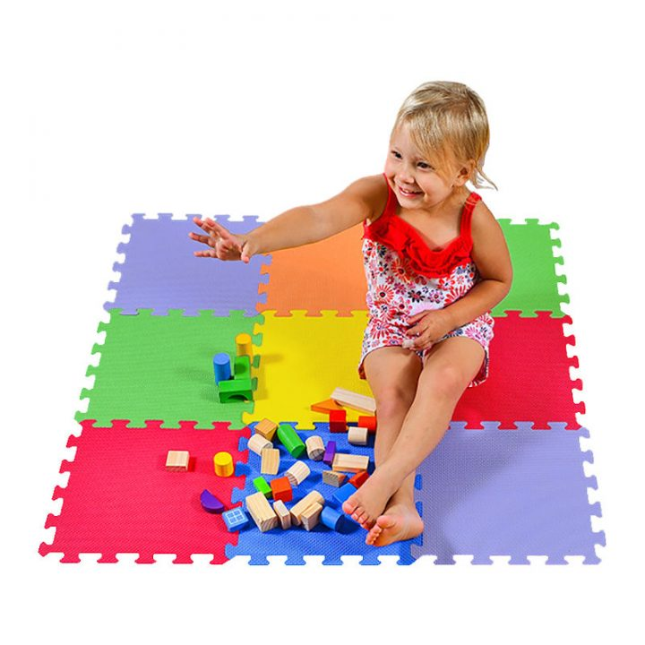 Kid Playing on Foam Puzzle Mat