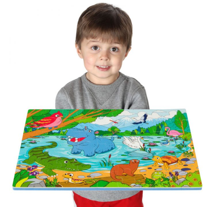 Kid Holding Assembled Lake Floor Puzzle