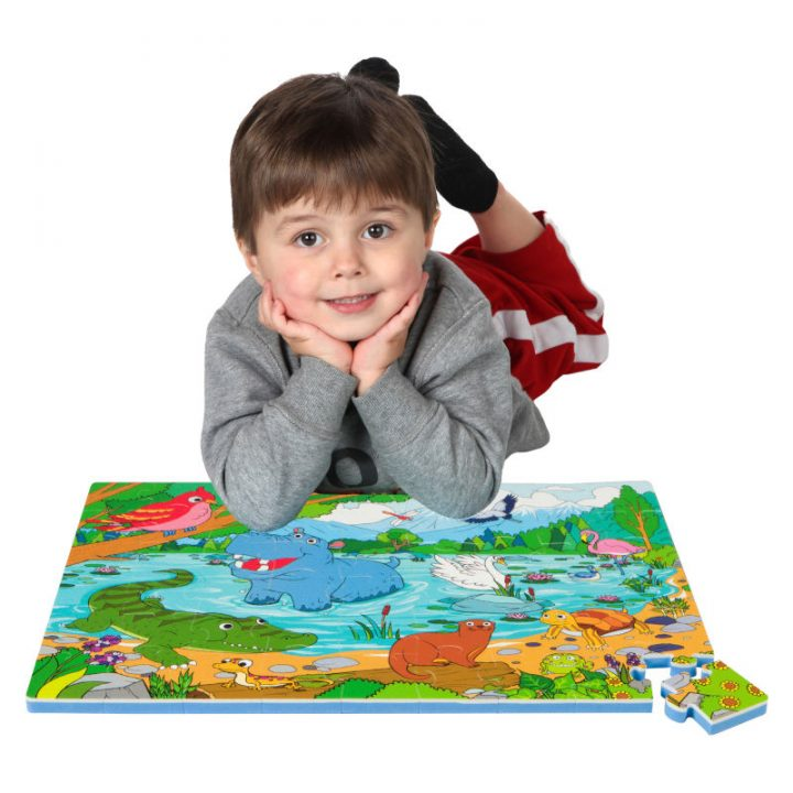 Kid Laying on Assembled Lake Floor Puzzle