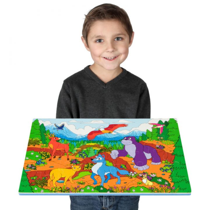 Kid Holding Assembled Mountain Floor Puzzle