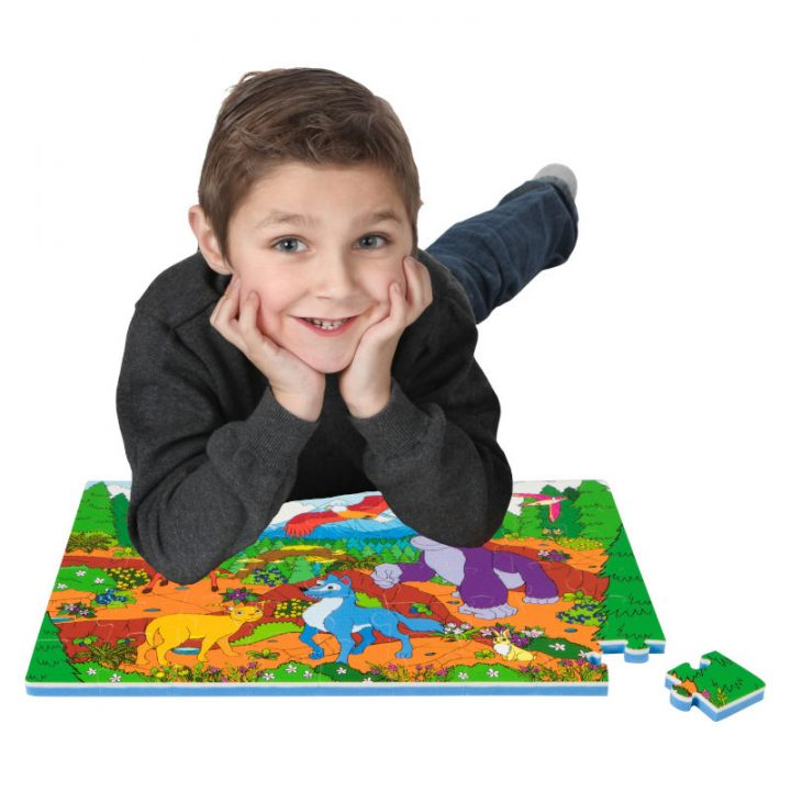 Kid Laying on Assembled Mountain Floor Puzzle