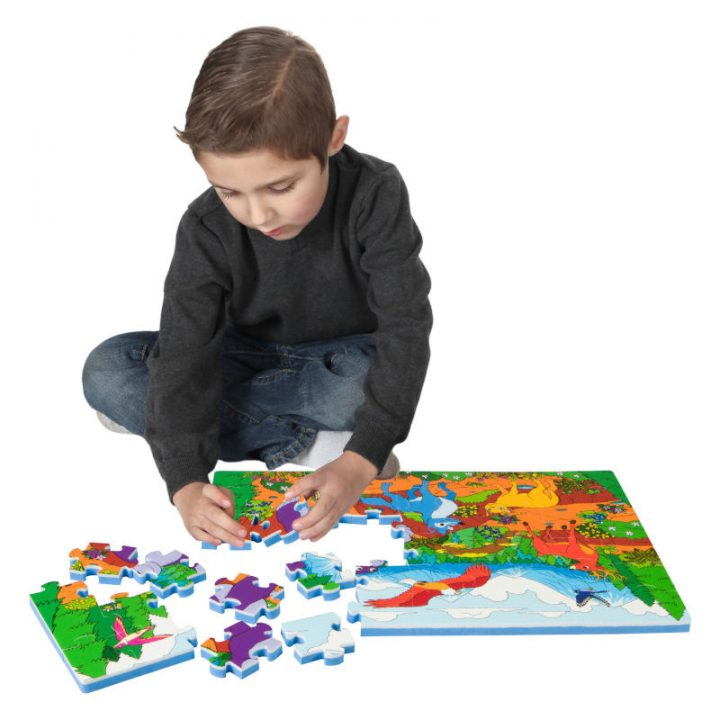 Kid Assembling Mountain Floor Puzzle