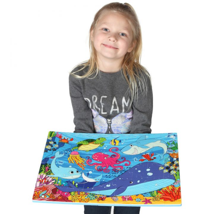 Kid Holding Assembled Sea Floor Puzzle