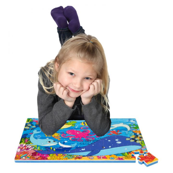 Kid Laying on Assembled Sea Floor Puzzle