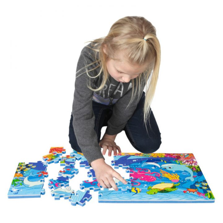 Kid Assembling Sea Floor Puzzle
